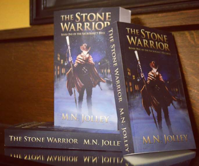 "The Sacrosanct Records, a planned series of Fantasy/Western Adventure novels. Book One, ""The Stone Warrior"", is complete, and set to be released on February 1st. Books 2 is in progress, and Book 3 is planned and outlined."